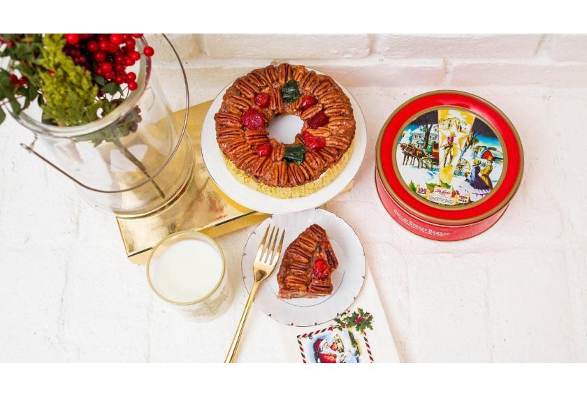 DeLuxe Fruitcake on Fireplace Ledge for Santa hero