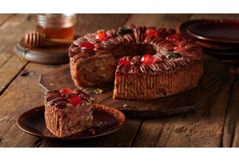 Large DeLuxe Fruitcake from Collin Street Bakery on Rustic Table Setting v2 hero