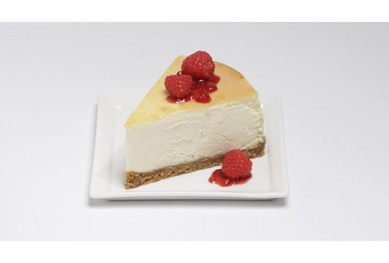 SIngle slice of New York Style Cheesecake Featured Image hero