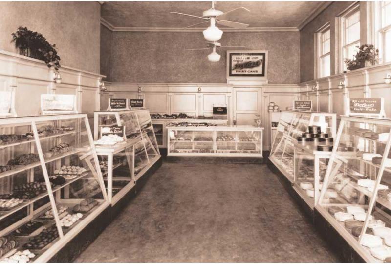 Throwback thrusday collin street bakery deluxe fruitcake interior bakery cases hero