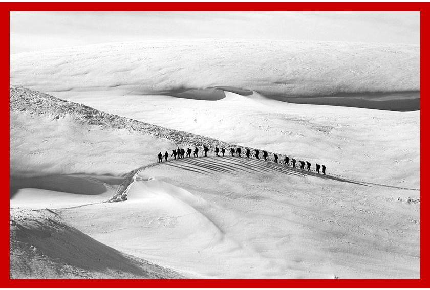 Fruitcake in Antarctica - Hikers Crossing Snow Hills