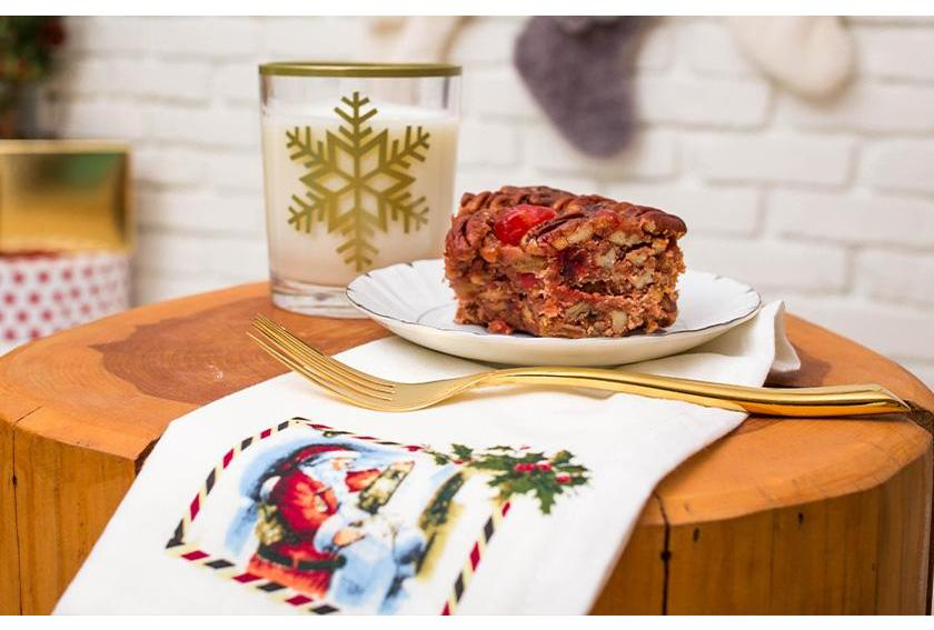 Milk and Fruitcake Setting by Fireplace for Santa