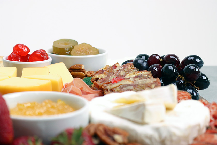 DeLuxe Fruitcake, Fruit, Meat, & Cheese Tray Close Up